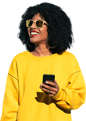 Smiling woman wearing sunglasses and looking up