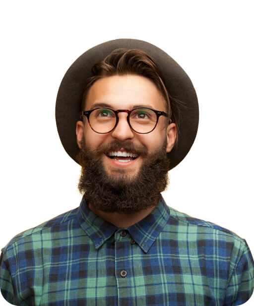 Man wearing glasses and hat looking in front and smiling