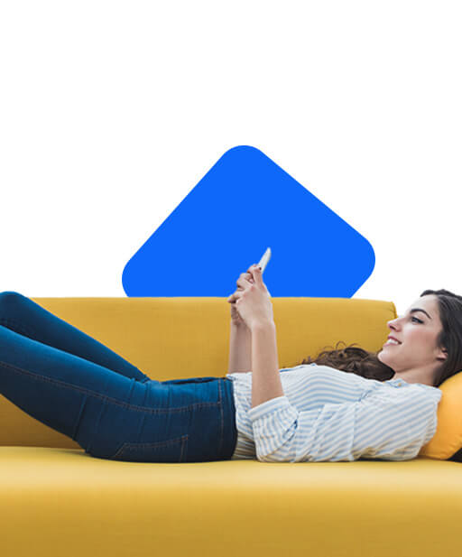 Girl lying on the couch with her smartphone